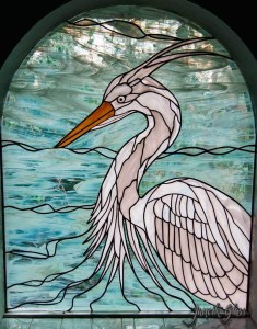 Residential stained glass window of a heron